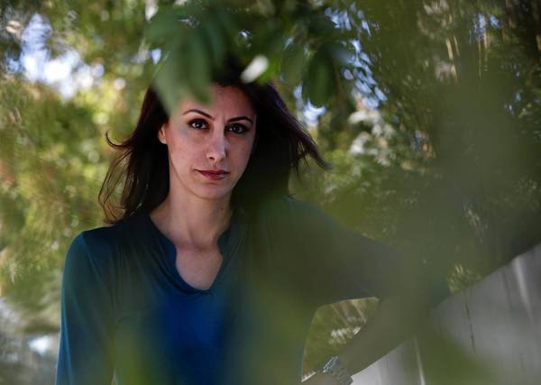 Los Angeles County social worker Azar Namin said she usually extends her current health plan policy from her employer each year. But this year, with new choices, she is exploring her options.