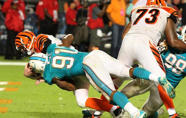 Miami defensive end Cameron Wake sacks Cincinnati quarterback Andy Dalton for a game-winning safety in overtime. The Dolphins won, 22-20.