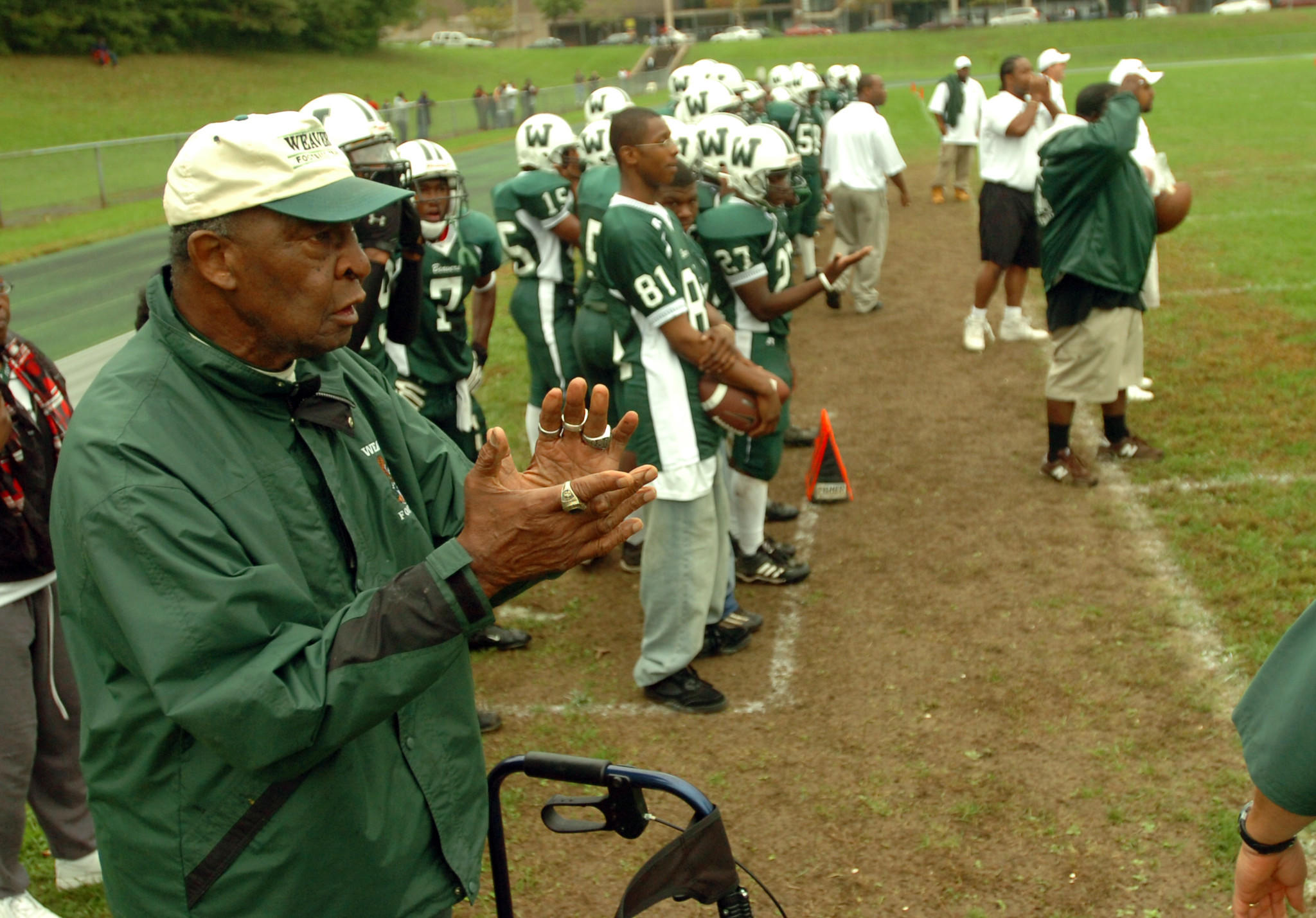 Doc Hurley cheers on the Weaver High School football team at a home game against Bulkeley on Sept. 23, 2006. Hurley, a former Weaver teacher and coach, served as honorary Weaver football coach for the day.