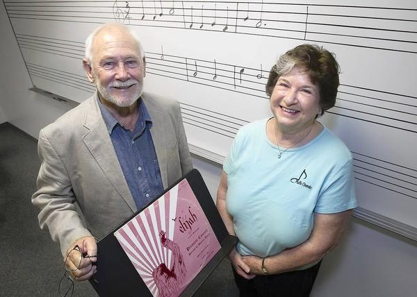 James Dunning and Rita Major, the longest standing members of the Pacific Chorale, pose with a record from the Chorale's first show in the Music and Media Building at the University of California, Irvine.