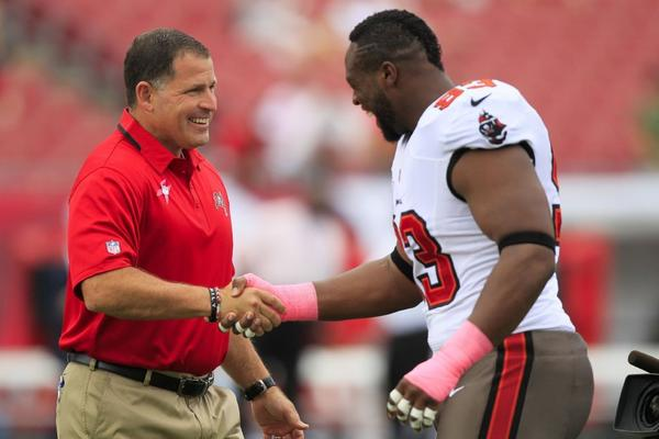 Tampa Bay Buccaneers Coach Greg Schiano shakes hands with Gerald McCoy before the Oct. 13 game against Philadelphia.