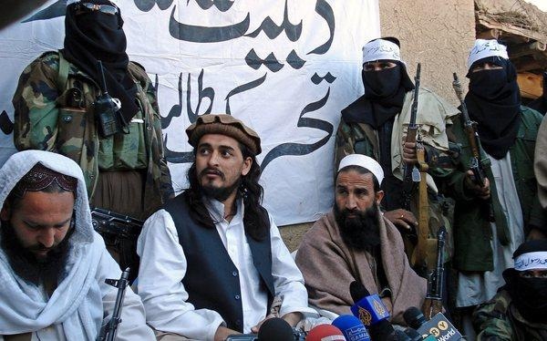 A picture dated Nov. 26, 2008 shows Hakimullah Mehsud, second left, leader of Pakistani Taliban, among other unidentified fighters talking with journalists in Pakistan near the Afghan border.