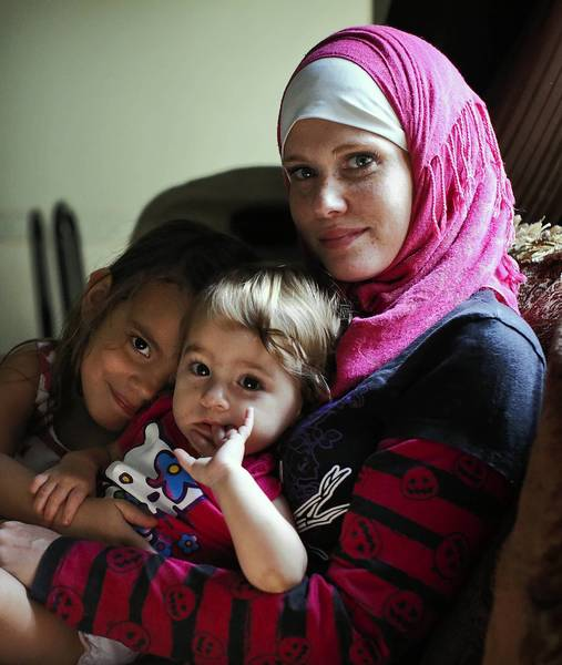 Rose and her daughters A'isha, left 4, and Tziphorah, 1, at their Kissimmee home on October 31, 2013. Rose, a Muslim, believes that she was the victim of a hate crime after another driver tried to run her off of the road while mocking her mocking her head scarf. (Jacob Langston/Orlando Sentinel) ORG XMIT: muslim-hate-crime-photo