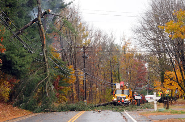 A downed tree and electrical fire on Lovley Street at Chevas Road in Avon Friday.