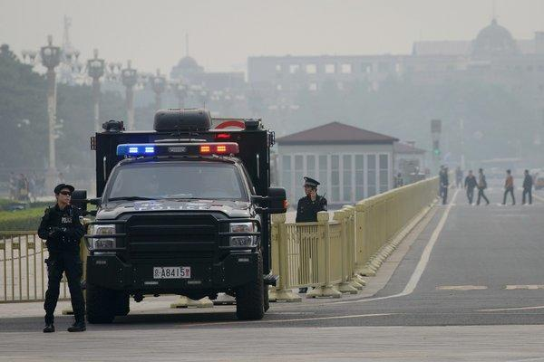 Armed police stand guard at Tiananmen Square in Beijing on Thursday.