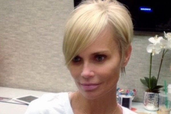 Kristin Chenoweth and her new pixie haircut, shot in mirror-image.