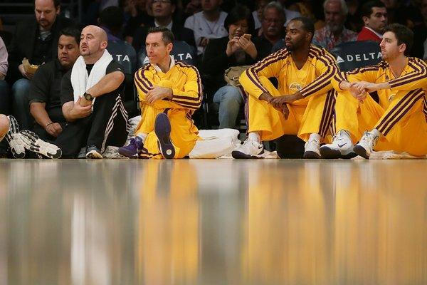 Lakers guard Steve Nash watches his team play on Oct. 22.