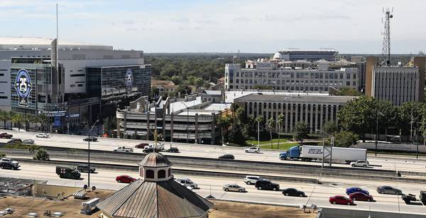 The Amway Center, left, Orlando Police Headquarters Building and city parking garage Friday, November 1, 2013.