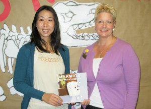 "Marie Chu (L) donates copies of her children's book ""Marmion the Marshmallow"" to the Williamsburg Regional Library. Accepting the donation is Youth Services Librarian Charlotte Wood."