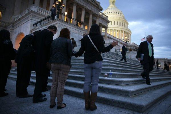 Immigration reform activists gather near the Capitol in Washington last week for a prayer and protest.