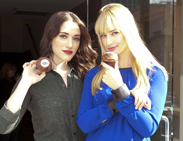 "Kat Dennings (left) and Beth Behrs of ""2 Broke Girls"" show off the 2 Broke Not So Vanilla cupcakes available at Sprinkles Cupcakes nationwide."