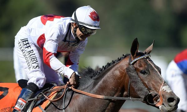 Jockey Mike Smith rides London Bridge to victory at the Breeders' Cup on Friday at Santa Anita.