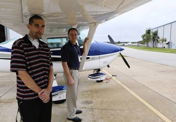 Steve Purello, CEO of Angel Flight and Jeb Bolivar, left, pose for a portrait at Leesburg Airport on Wednesday, September 25, 2013.