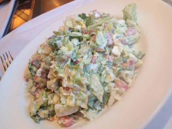 A former cook at Maison Marconi is preparing the Marconi's Salad a a featured menu item.