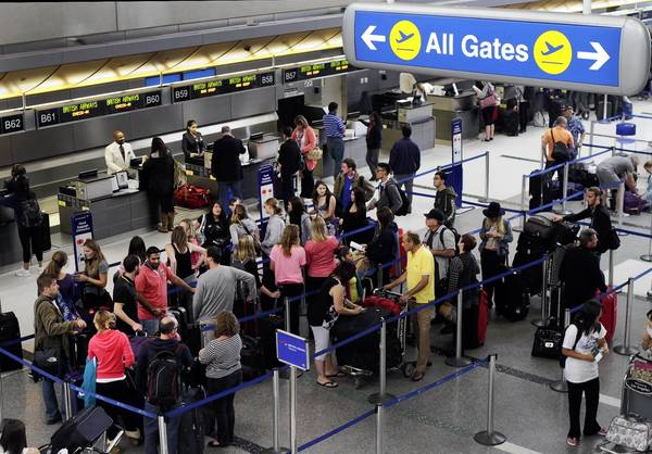 New technologies and tighter budgets have added to the complexity of safely transporting 2.6 billion air passengers a year worldwide. Above, travelers inside the LAX Tom Bradley International Terminal last year.
