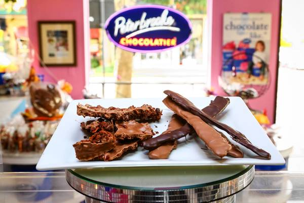 A plate of chocolate covered bacon strips and chocolate bark bacon at Peterbrooke Chocolatier on Park Ave in Winter Park on Thursday October 31, 2013.