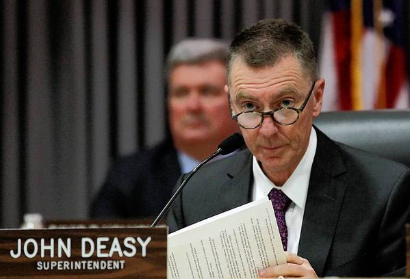 L.A. Unified School District Supt. John Deasy listens to public comments about his job performance during a school board meeting at LAUSD headquarters.