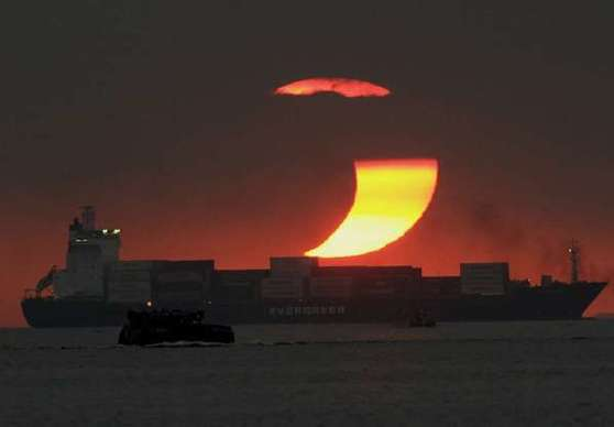 This 2009 partial eclipse of the sun occurred at sunset off the Philippines.