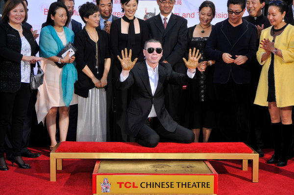 Director Feng Xiaogang leaves his handprints in cement at the TCL Chinese Theatre in Hollywood.