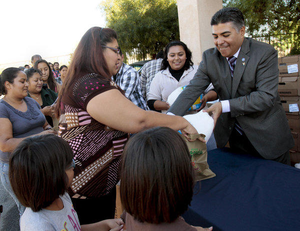 Rep. Tony Cardenas, then a Los Angeles councilman, gives turkeys to constituents in Sun Valley before Thanksgiving last year.