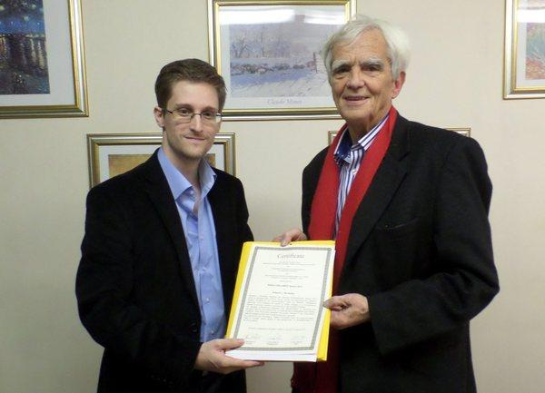 During a meeting in Moscow, German Greens Party lawmaker Hans-Christian Stroebele, right, handed fugitive NSA leaker Edward Snowden an honorary 2013 Whistleblower Award issued by German transparency advocates.