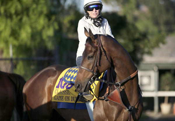 Game On Dude, with exercise rider Dana Barnes atop, gets ready for a morning workout at Santa Anita Park on Wednesday.