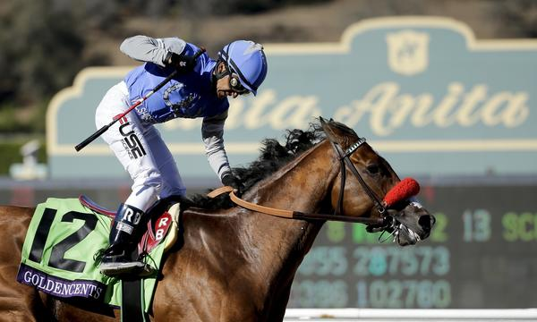 Jockey Rafael Bejarano celebrates after riding Goldencents to victory in the Breeders' Cup Dirt Mile at Santa Anita on Friday afternoon.