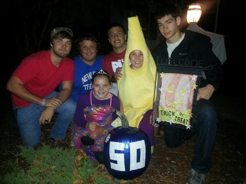 New Kent High School football captains took Jacob Vick's sisters  Lucy and Lauren trick or treating Thursday night. The Captains are, left to right, Taylor Vines, Wilson Gregory, Kevin Karaffa and Luke Mechling