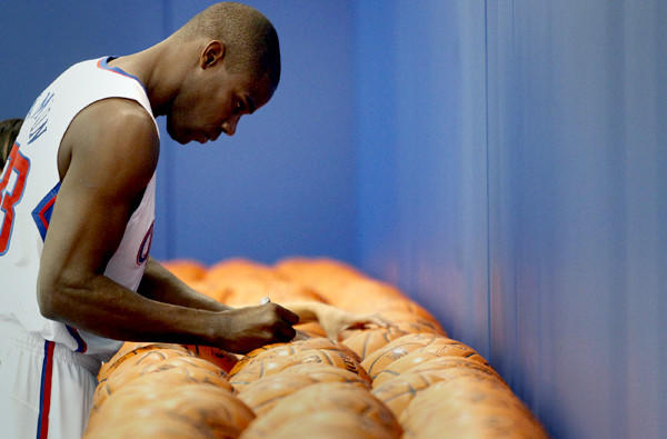 Veteran forward Antawn Jamison signs basketballs during the Clippers' media day.