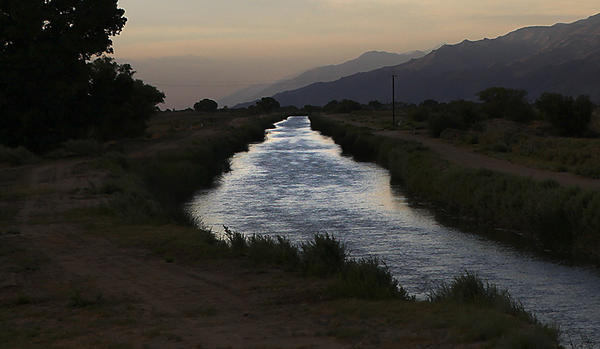 The Los Angeles Aqueduct flows in its unlined channel on the east side of the Sierra Nevada range north of Lone Pine.