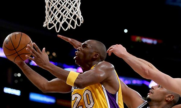 Lakers guard Jodie Meeks scores a basket in the final minute of the team's 91-85 loss to the San Antonio Spurs at Staples Center on Friday.