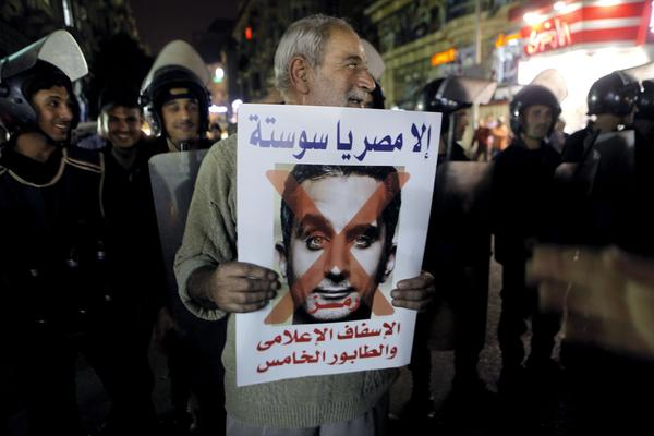 A supporter of Gen. Abdel Fattah Sisi protests comedian Bassem Youssef at a Cairo rally.