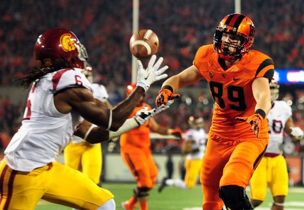 USC safety Josh Shaw, left, intercepts a pass intended for Oregon State tight end Connor Hamlett in the first half.