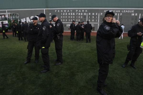 Members of the Boston Police Department prepare for the Red Sox World Series parade at Fenway Park.