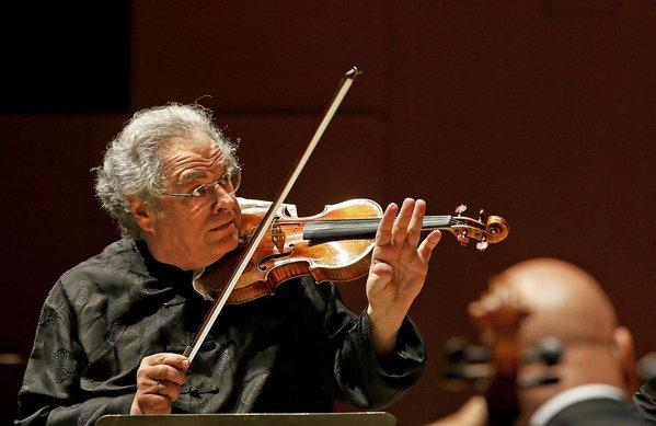 Itzkhak Perlman does double duty as he plays the violin and conducts the L.A. Phil in three programs.