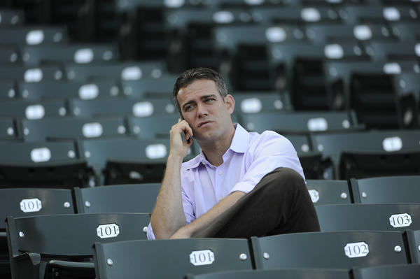 Theo Epstein watching batting practiced during a May game at Wrigley.