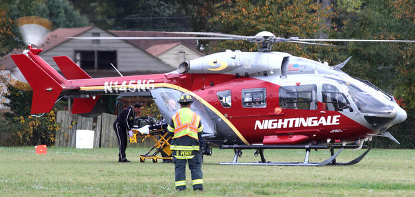 The victim of a crash at the corner of Bellwood Dr. and Tyler Ave. is loaded into the Nightingale helicopter for the trip to Norfolk Saturday behind Crittenden Middle School.
