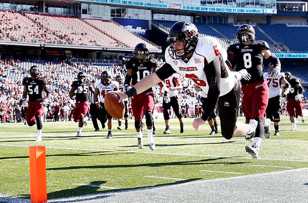 Northern Illinois quarterback Jordan Lynch dives for the goal line as he scores a touchdown against Massachussets in the first quarter Saturday.