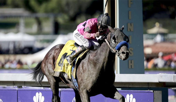 New Year's Day, trained by Bob Baffert, sprints to victory at the Breeders' Cup in the Juvenile race at Santa Anita Park on Saturday.