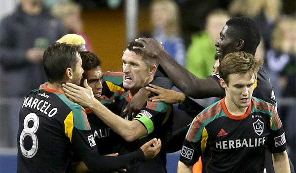 Robbie Keane, center, celebrates a goal against the Seattle Sounders during the Galaxy's 1-1 draw on Oct. 27. L.A. will face Real Salt Lake in the playoffs as it goes for its third MLS title in a row.