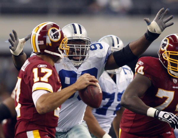 The Cowboys' Jay Ratliff (90) pressures Redskins quarterback Jason Campbell during a 2009 game.