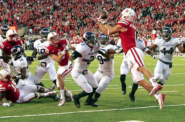 Nebraska receiver Jordan Westerkamp catches the game-winning touchdown pass over Northwestern defensive back Dwight White (2), safety Jimmy Hall (9) and linebacker Chi Chi Ariguzo (44) on the last play of the game Saturday in Lincoln, Neb.