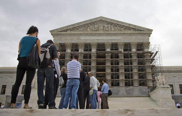 People wait in line outside the Supreme Court on Oct. 7.