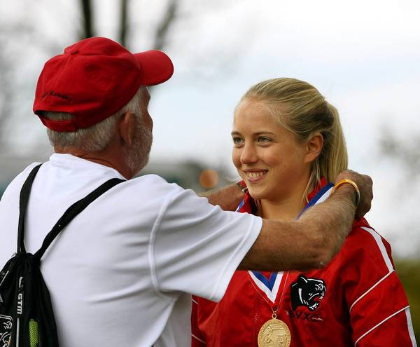 Saucon Valley's Elizabeth Chikotas (right) gets her first place medal from her coach Ed Kolosky during the PIAA Girls class 2A Cross Country Championships at the Parkview Course in Hershey on Saturday, November 2, 2013.