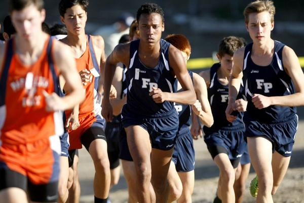 Flintridge Prep senior Alan Yoho, center, won Saturday afternoon's Prep League boys' cross-country individual championship at Pierce College in tying for the league's best time ever of 15:18. His sister, Sarah Yoho, won the girls' varsity title in 18:52. (Raul Roa/Staff Photographer)