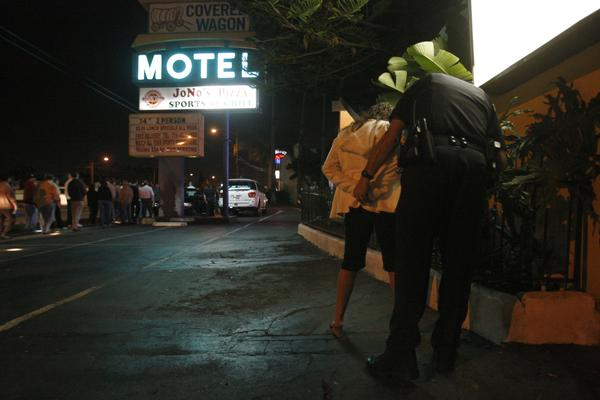 Anaheim police handcuff a woman during a crackdown on prostitution in 2012; surveys over the past two decades have indicated a decline in the percentage of men who say they have paid for sex--or been paid for it.