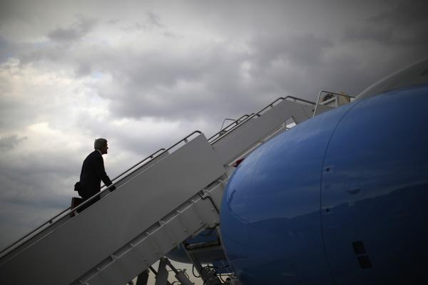 U.S. Secretary of State John Kerry steps aboard his aircraft at Andrews Air Force Base on his way to Egypt.