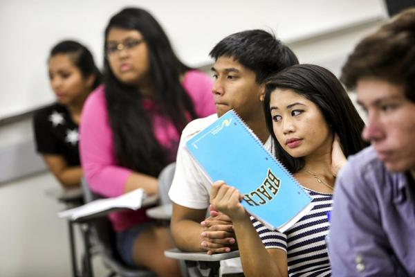 Students take an Asian American Studies class at Cal State Long Beach. Ethnic studies programs at several Cal State campuses and elsewhere are facing downsizing, mergers or outright elimination due to budget cuts and other pressures.