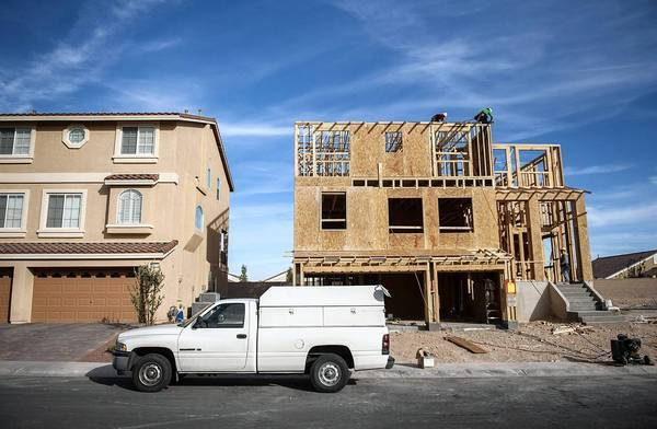 Houses in Nevada are likelier to have a seven in the list price than houses elsewhere in the nation, a study found. Above, a file photo shows a home under construction in Las Vegas.
