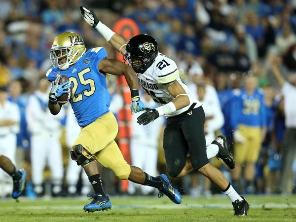 Buffaloes safety Jared Bell chases down Bruins running back Damien Thigpen on a 27-yard gain to the eight-yard line that set up a UCLA touchdown in the fourth quarter.